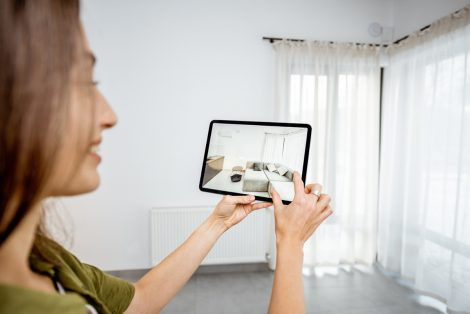 Young Woman Placing New Furniture On A Digital Tablet Into The E